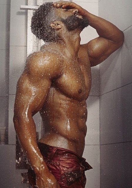 muscled guy taking shower