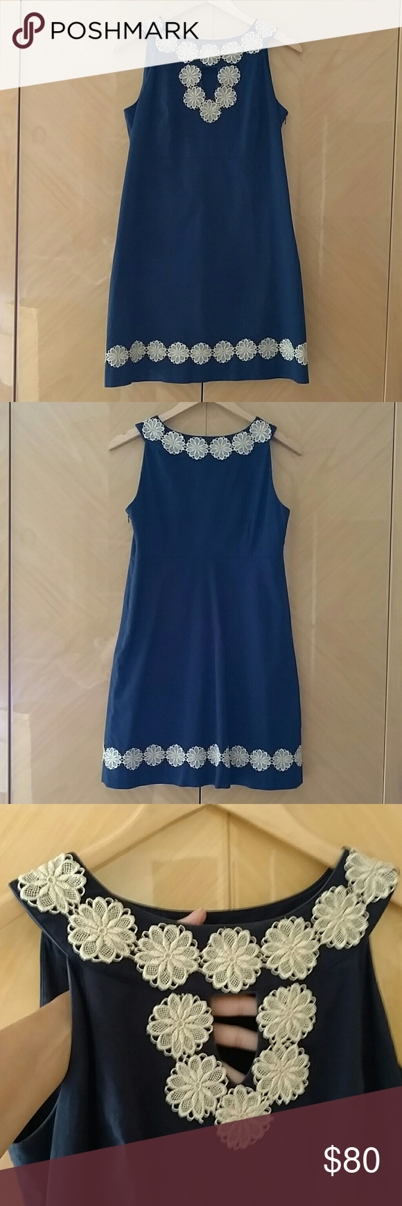 Lilly Pulitzer navy dress 4 Lilly Pulitzer navy dress. Cream flowers crochet details. Front eyelet. Side zipper. Worn once. Size 4. Price is FIRM, no offers will be accepted Lilly Pulitzer Dresses Mini