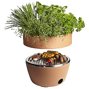 What a wonderful & unique idea! The Black and Blum Hot-Pot BBQ features the unlikely--yet wonderfully successful--pairing of an herb garden with a barbecue. When fully assembled, it looks like a terracotta flower pot, but actually conceals a compact charcoal grill underneath. The removable top is perfect for growing fresh herbs to season the very food being grilled