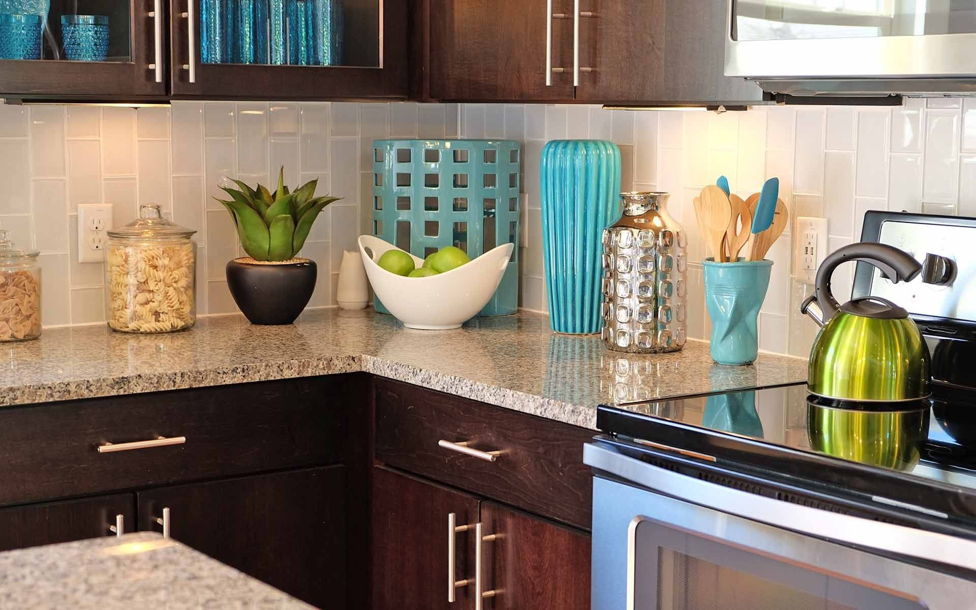Add Pops Of Color As You Decorate Your New Kitchen Blues And Greens Help Brighten Up A Kitchen W Budget Kitchen Remodel Kitchen Remodel Brown Kitchen Cabinets