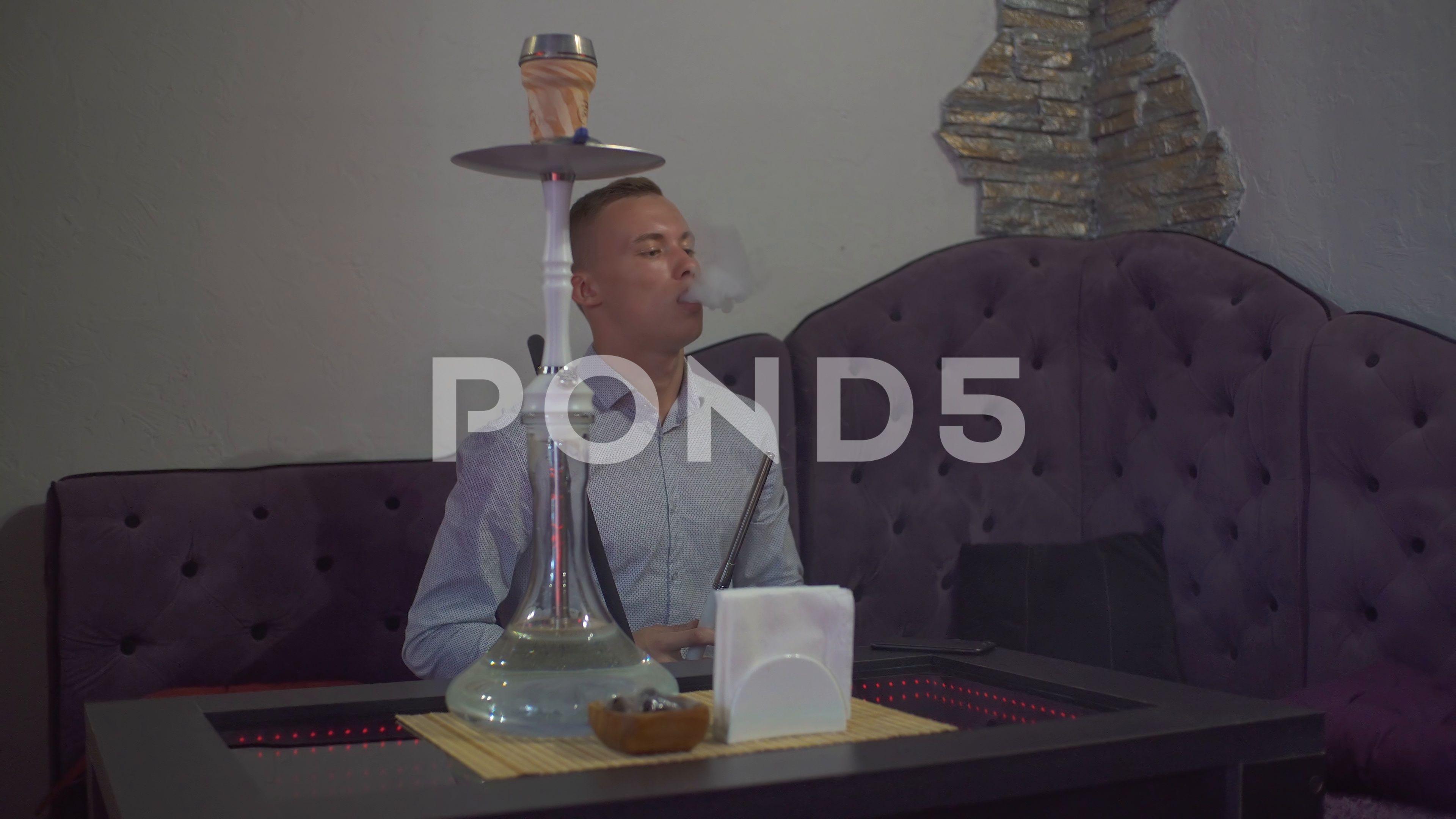 A Young Guy Smokes A Hookah Exhales Smoke Hookah Smoke Close Up