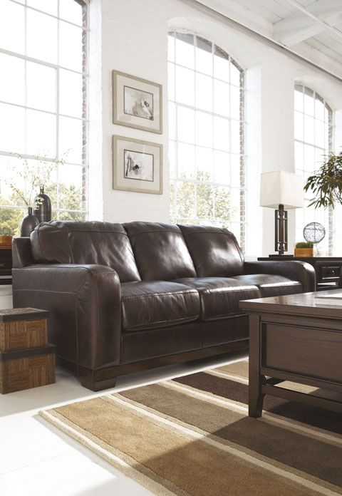 Crestwood walnut sofa A best seller at the ASHLEY Furniture