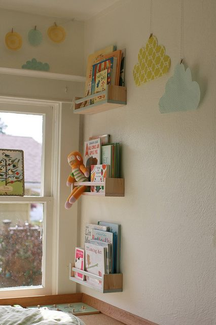playroom | reading nook DIY ikea spice racks paper clouds on clips | supergail flikr $3.99 at ikea