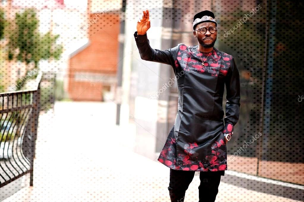 Handsome afro american man wearing traditional clothes, cap and - Stock P ,