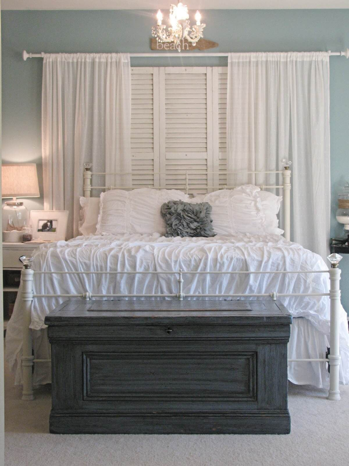 Old window over bed   ways decorating with old shutters can make your home charming