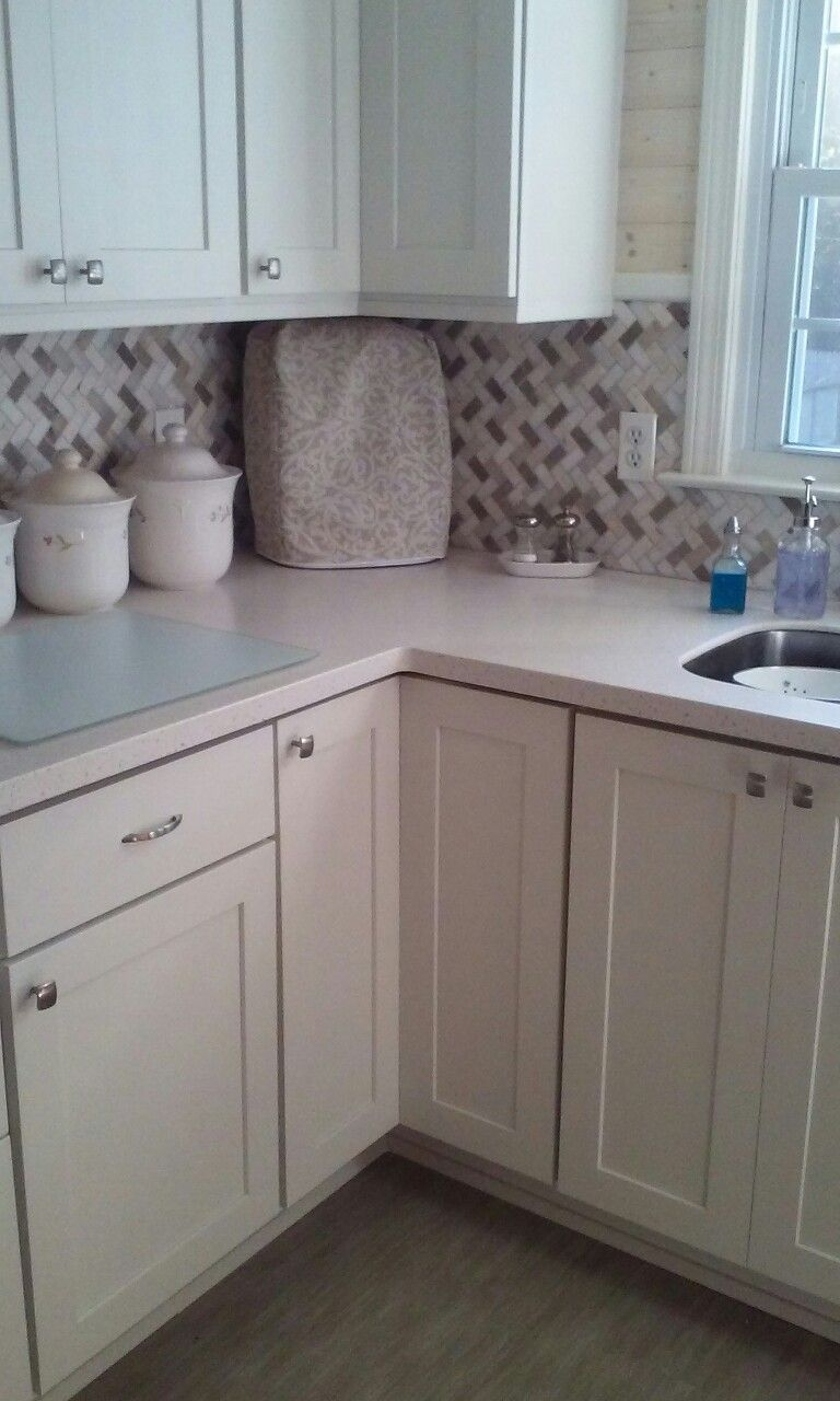 Marble herringbone backsplash and solid surface counters from ...