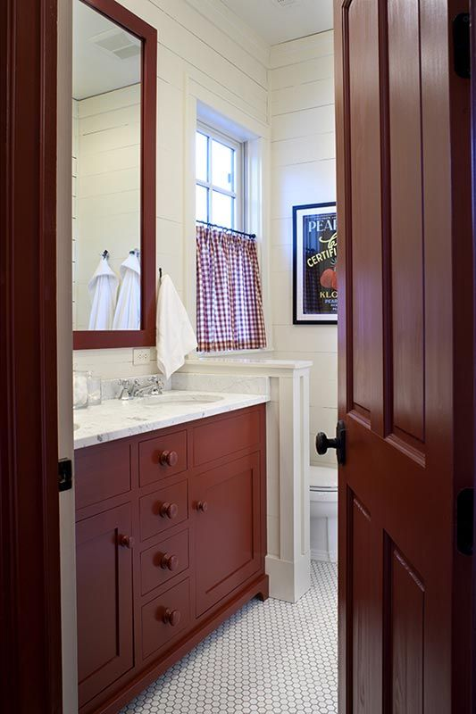 Love this bathroom with cabinets and mirror painted in benjamin moore country redwood color - Red bathroom color ideas ...