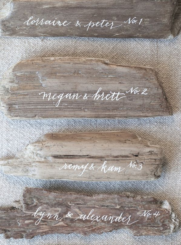 peaceful-seaside-wedding-inspiration-driftwood-table-number-ideas