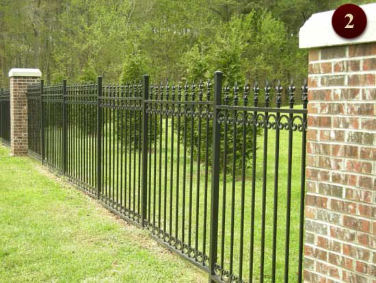 Wrought iron fencing raleigh custom aluminum fences for Brick and wrought iron fence designs