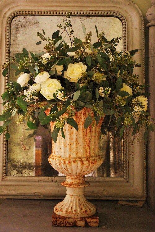 Roses in a rusty urn