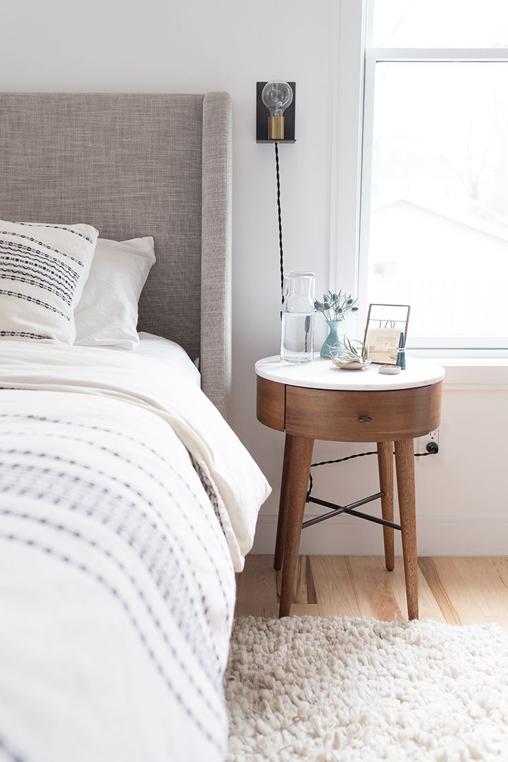 Clean And Bright Bedroom With Marble Topped Bedside Table