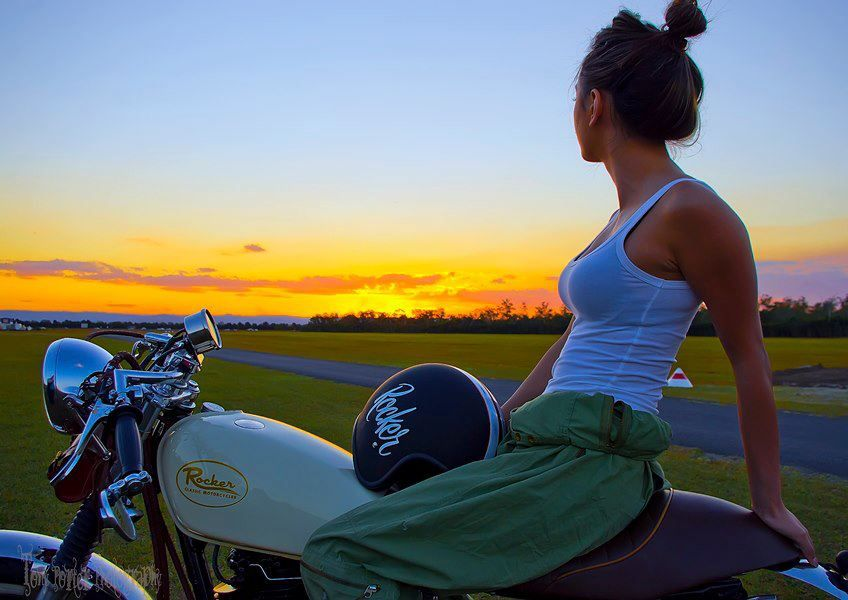 Girl enjoying the sunset with a gorgeous retro custom from Rocker Classic Motorc…