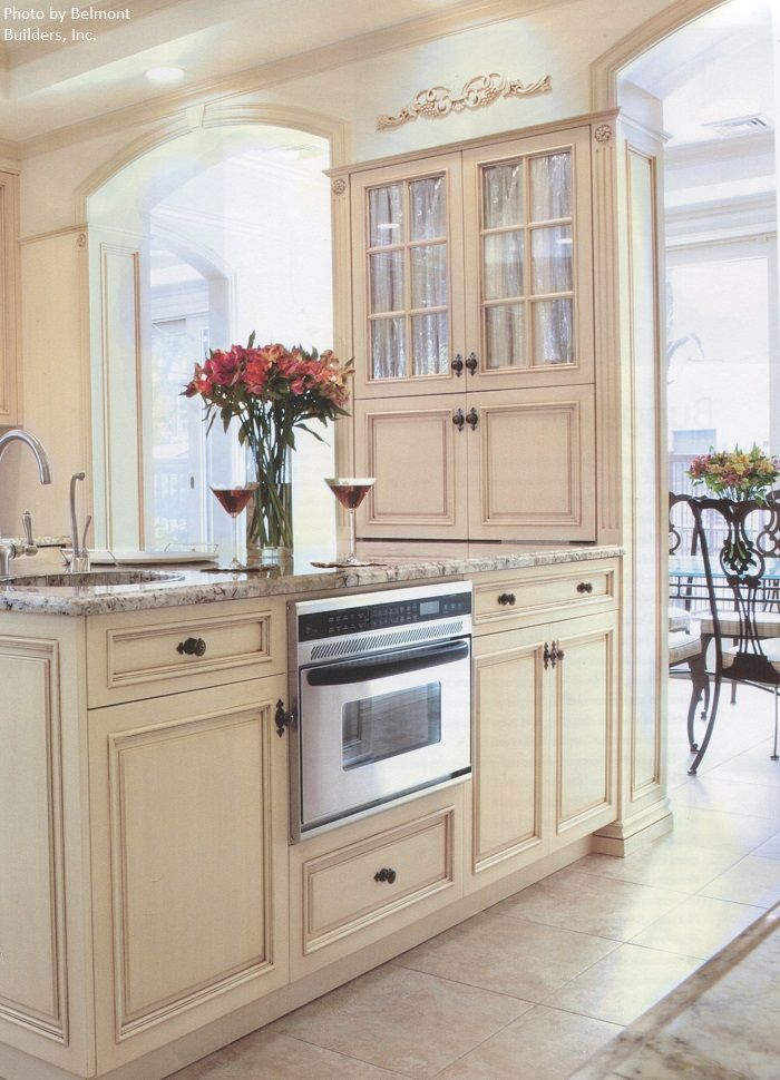 An Old World Kitchen With Silver Arched Neck Faucet, Light
