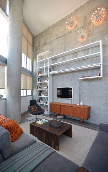 The Minimalist Living Room Of A Two Story Loft Designed By Laura Schwartz Muller For
