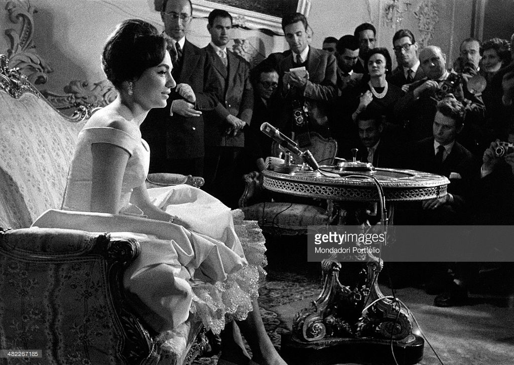 Mohammad Reza Pahlavi's fiancée and the future empress of the Iran Farah Pahlavi (Farah Diba) attendign a press conference on the eve of her wedding. December 1959