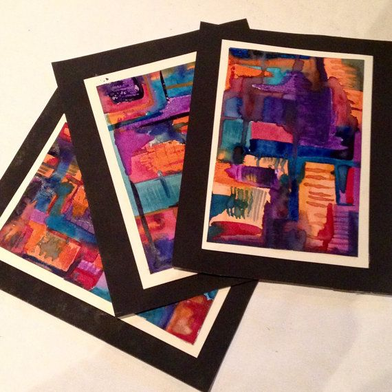 7.75 in by 6 in Watercolor and oil pastel Set of three Hand made original nonobjective paintings Black matting not framed