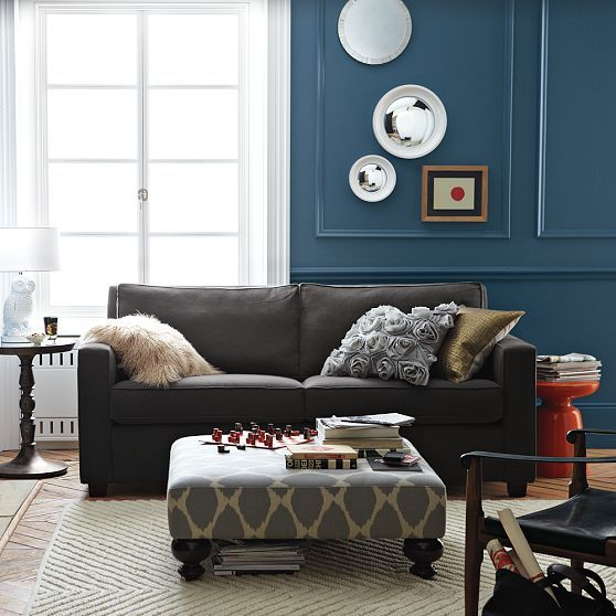 Dark Blue Walls, Ikat Ottoman, Red/orange Accent Table