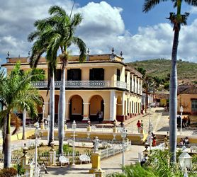 The beautiful Plaza Mayor in http://CubaTrinidad.com has numerous communal gardens on raised platforms, with pedestrian walkways traversing each garden. As a result the four small garden beds are fenced off by the original white wrought-iron fences of the day which have stood the test of time