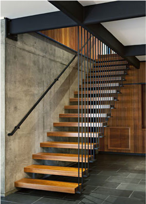 Hanging Wooden Stairs Cement Wall And Black Beams Cabin