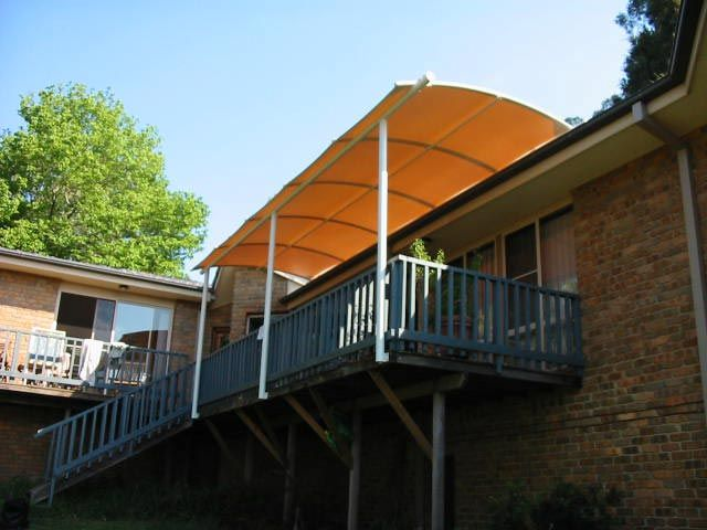 Roof Mounted Curved Batten Awning in Ferrari 502 PVC Rainproof Fabric