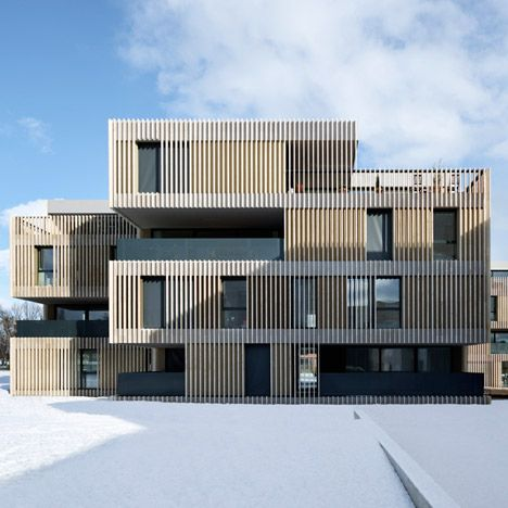 Apartment Buildings By Group8 Clad In Strips Of Travertine