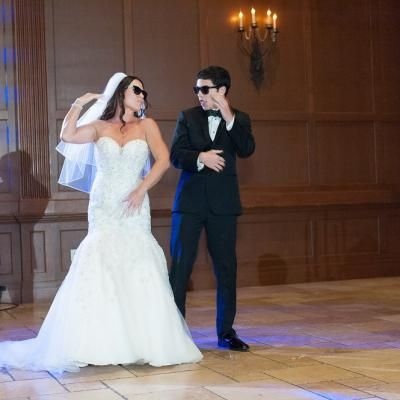 The Bride And Groom Have Fun During Their Grand Entrance With Sungles Dance Moves