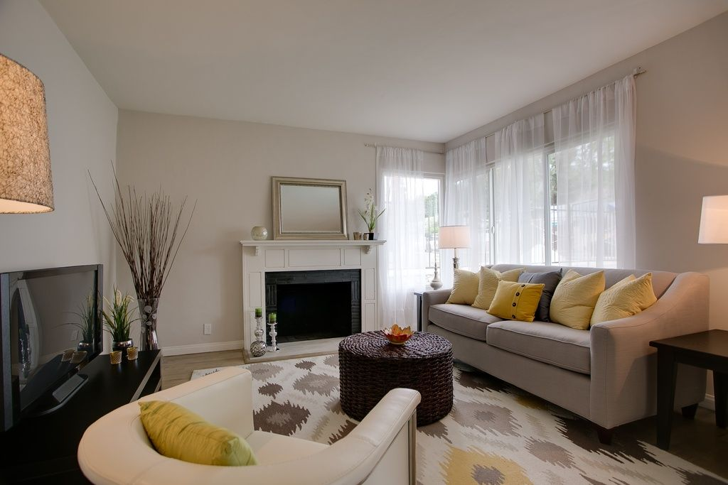Contemporary Living Room With High Ceiling West Elm Paidge Sofa Bancroft Gold Ikat Area Rug By Wade Logan Ft X 8