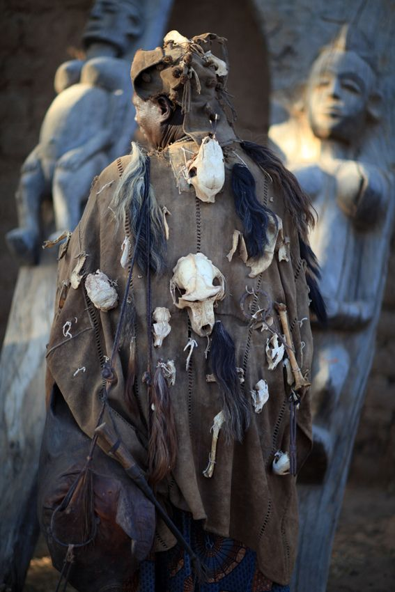 Africa | Dogon hunter wearing a traditional tunic; they display the skulls of hunted animals on their tunics. Dogon country, Mali | ©marsoyann, via flickr