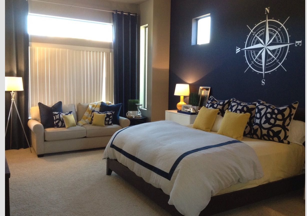 navy blue accent wall yellow accents master bedroom. Black Bedroom Furniture Sets. Home Design Ideas