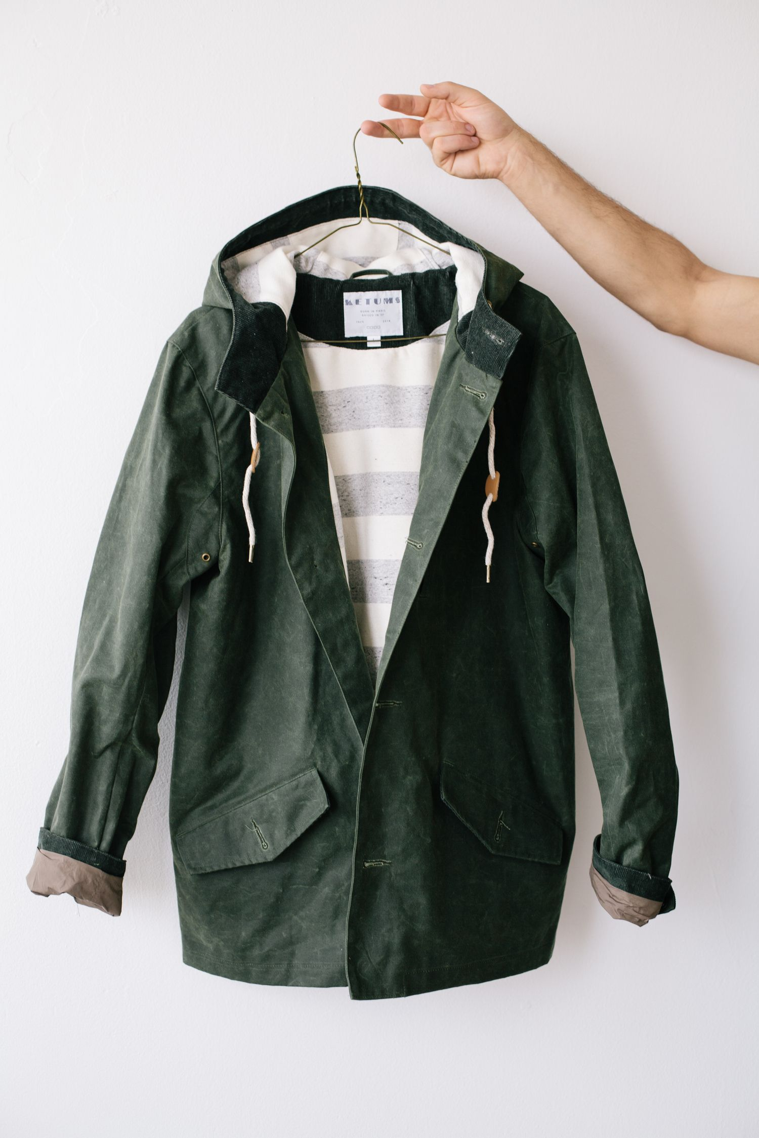 Waxed canvas jacket from Ketums. Looks like the kind of military jacket that would be easy to layer under and would hold up to Pacific Northwest weather.
