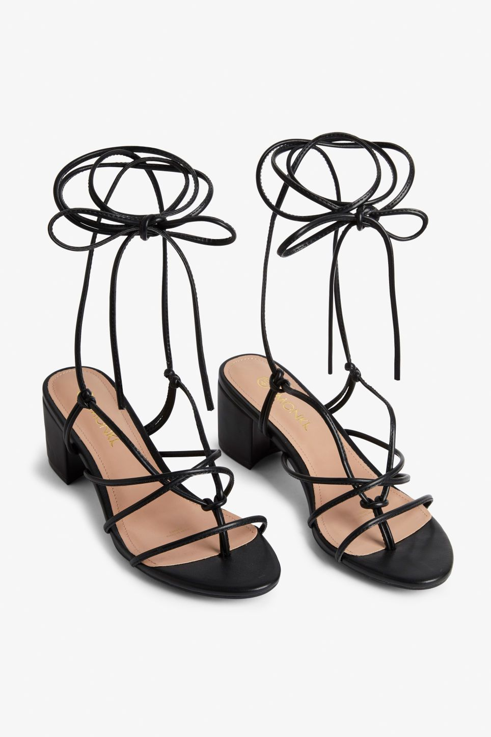 f932ac28e4aee6 A pair of heeled ankle-wrap sandals made from faux leather. Yaas! Heel  height  6