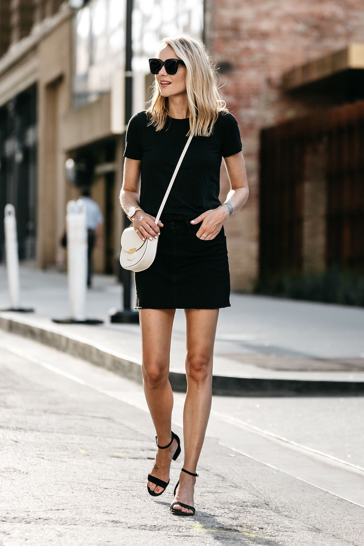 c40975ba7b3 Blonde Woman Wearing Everlane Black Fitted Tshirt Frame Black Denim Skirt  Outfit Celine White Trotteur Handbag Black Ankle Strap Sandals Fashion  Jackson ...