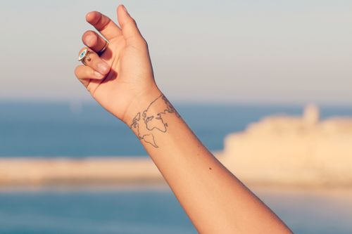 21 tattoos you wont live to regret hopefully regrets tattoo livingdoll wrist tattoo the world gumiabroncs Choice Image