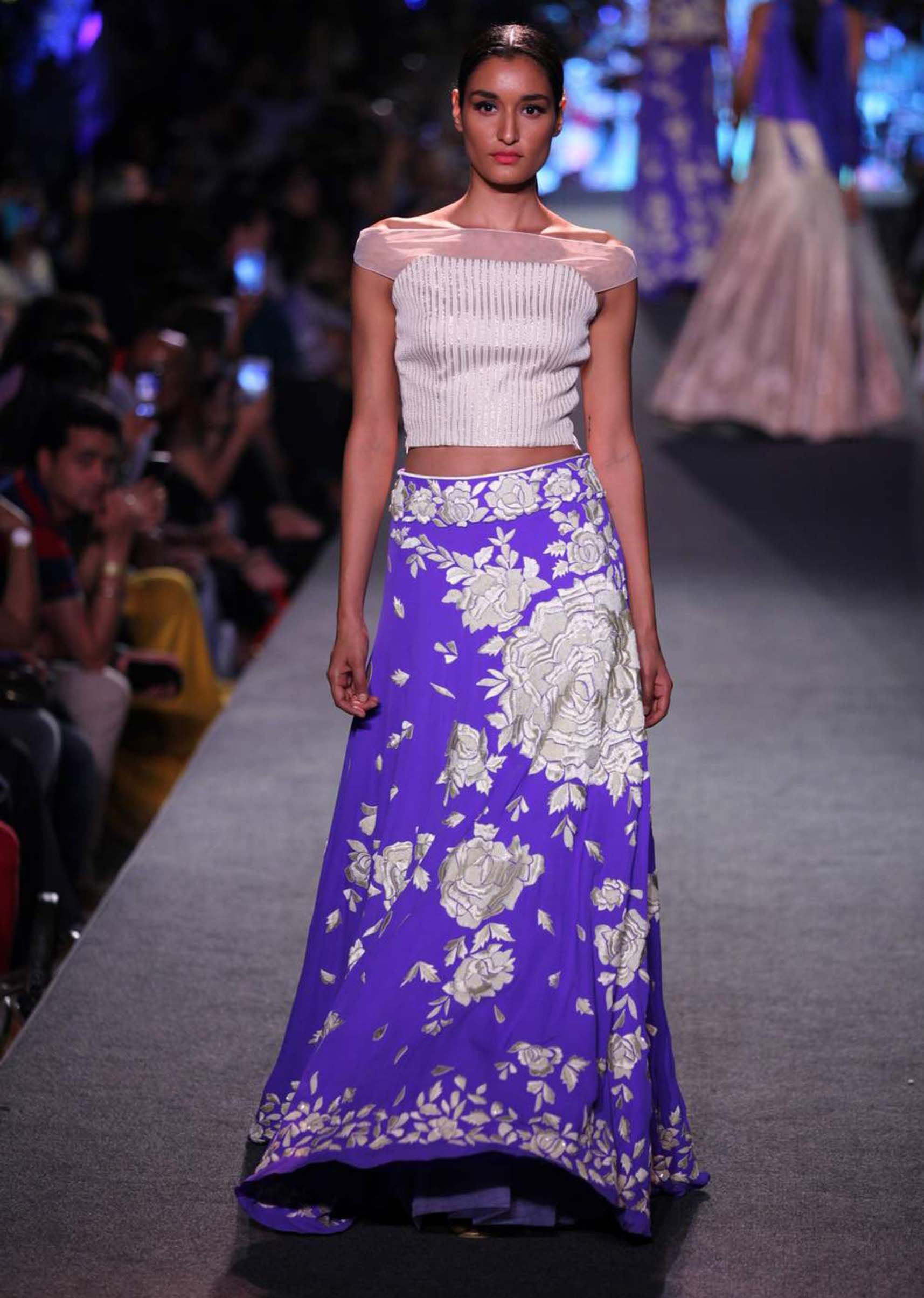 Model walks the ramp in purple lehenga with rose motif for Manish ...