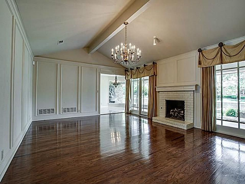 White on white painted picture frame paneling and brick fireplace ...