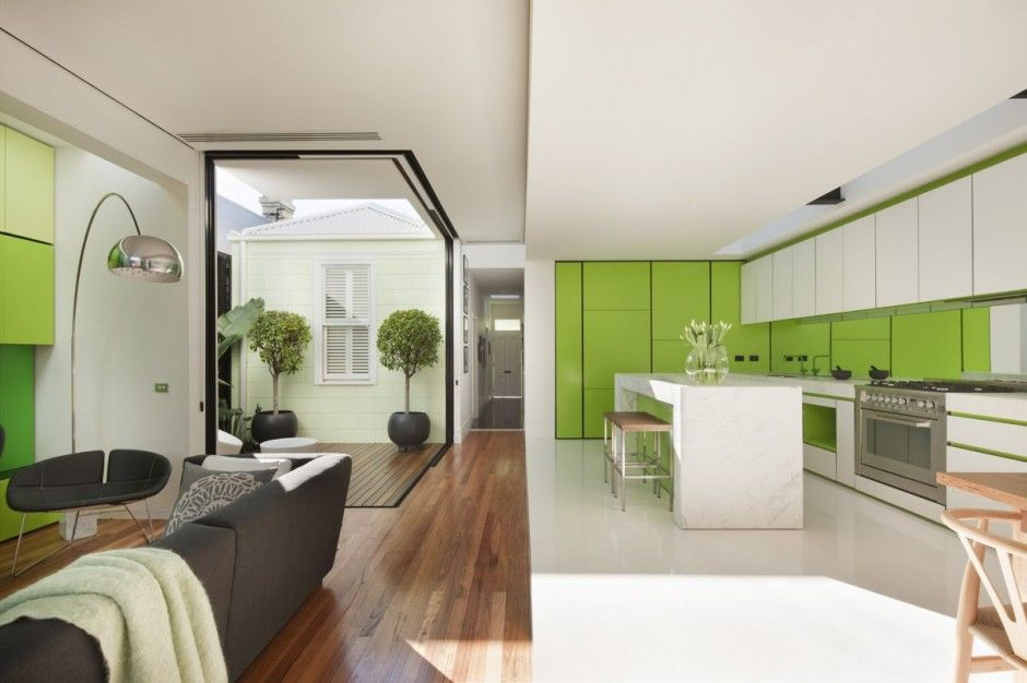 medium wood floor, white walls with monochromatic (green) accent