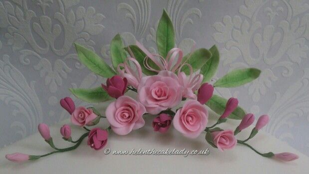 Pink roses and fresias sugar flowers. Visit my page www.helenthecakelady.co.uk