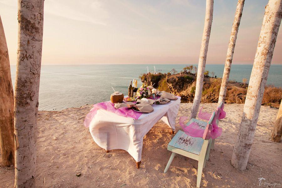 Destination wedding ceremony on cliff in Bali, Indonesia