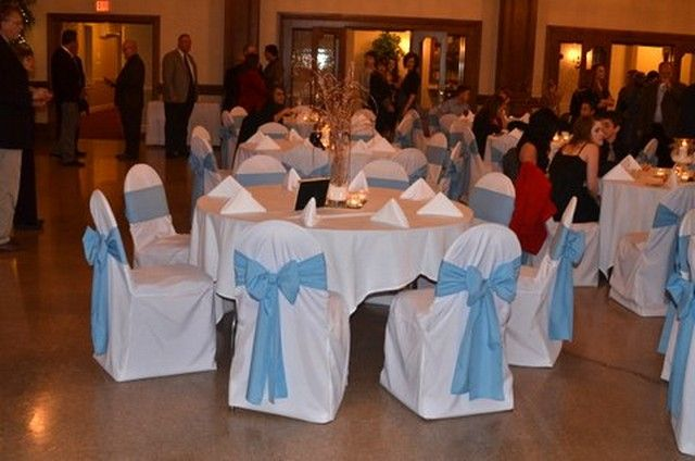 White Tablecloths And Chair Covers With A Beautiful Pale Blue Sash Tied In Bow