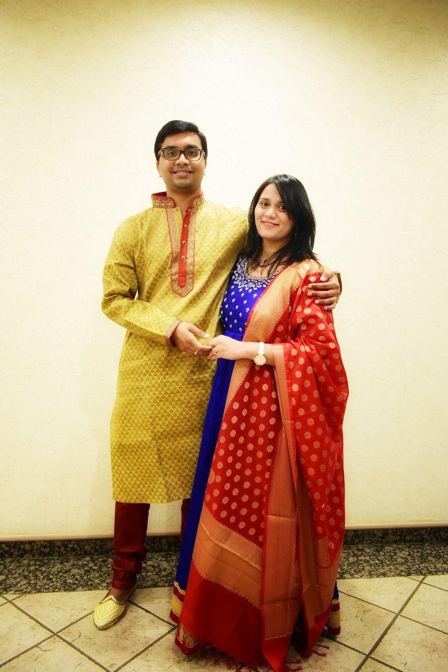Husband and wife pose Birthday attire Baby boy Hima