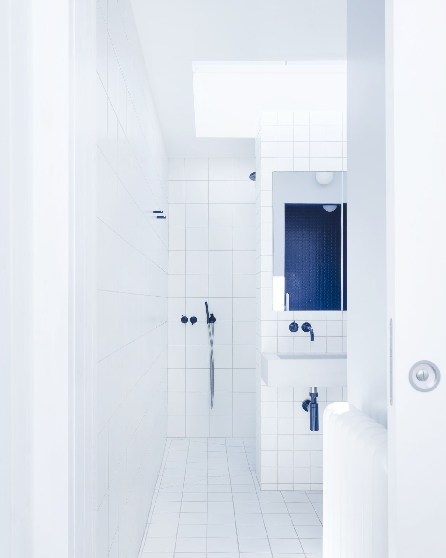 The en-suite blue-and-white master bath makes use of standard white ...