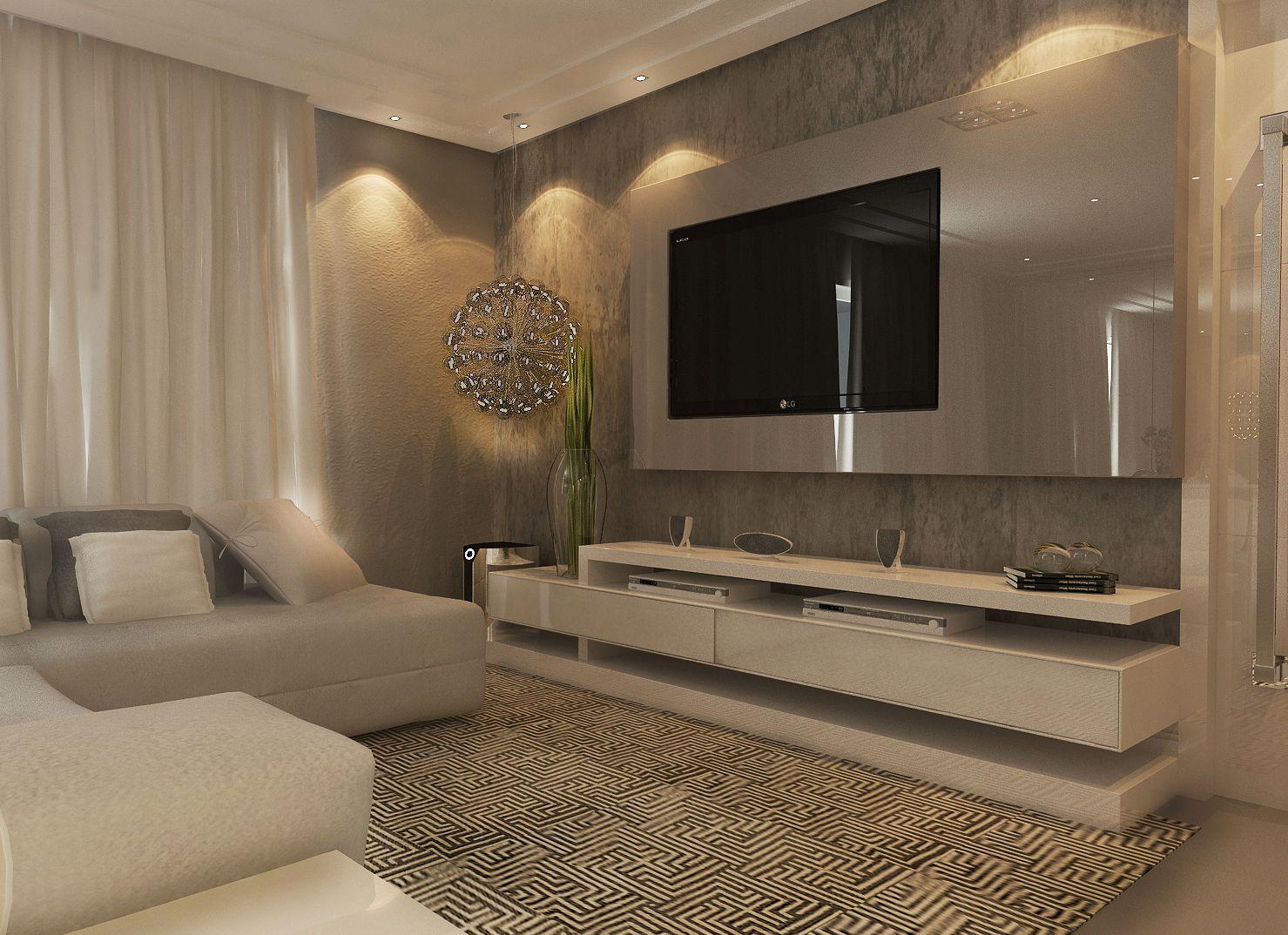 O painel de vidro acomoda o televisor de forma elegante for Espejos finos decorativos