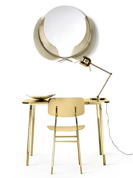 """The Sunset Mirror is a wall mirror designed by Nika Zupanc for Ghidini 1961.  The mirror, part of the """"Take me to Miami"""" collection, encapsulates the spirit of sultry heat, magical sunsets and 1950s glamour perfectly; the palm fronds on the fringe of the mirror offering an exotic hint of paradise."""