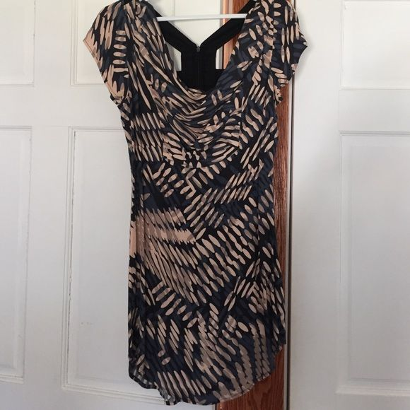 Hype sz 4 dress Short Hype sz 4 dress in black, blue and light pink/peach print. Cowl front neckline, zippered back closure with open cross detail. Hits above the knee but rises up the thigh slightly at the sides. Excellent condition! Only worn once. Hype Dresses Mini
