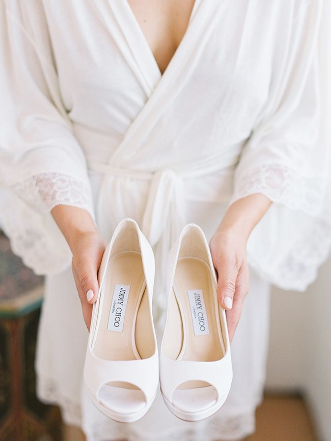 6c5e29245213 Bridal white Jimmy Choo shoes   Photo by Lane Dittoe fine art wedding  photography