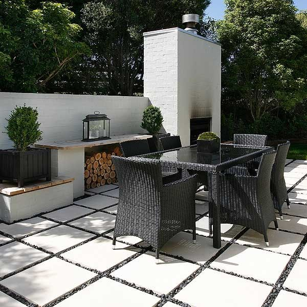 pebbles between pavers | White pavers with black stones ... on Black And White Patio Ideas id=85196