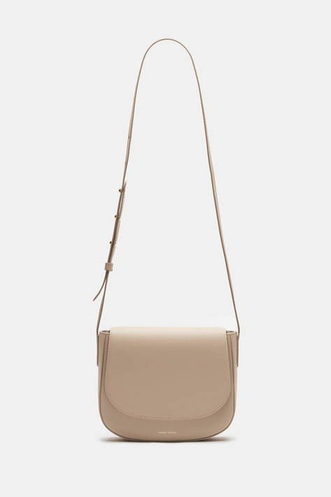Combining the smooth curves of a saddlebag with the ease of hands-free  carrying, this crossbody style has an understated elegance that is  synonymous with ... 2ff3b4c30b