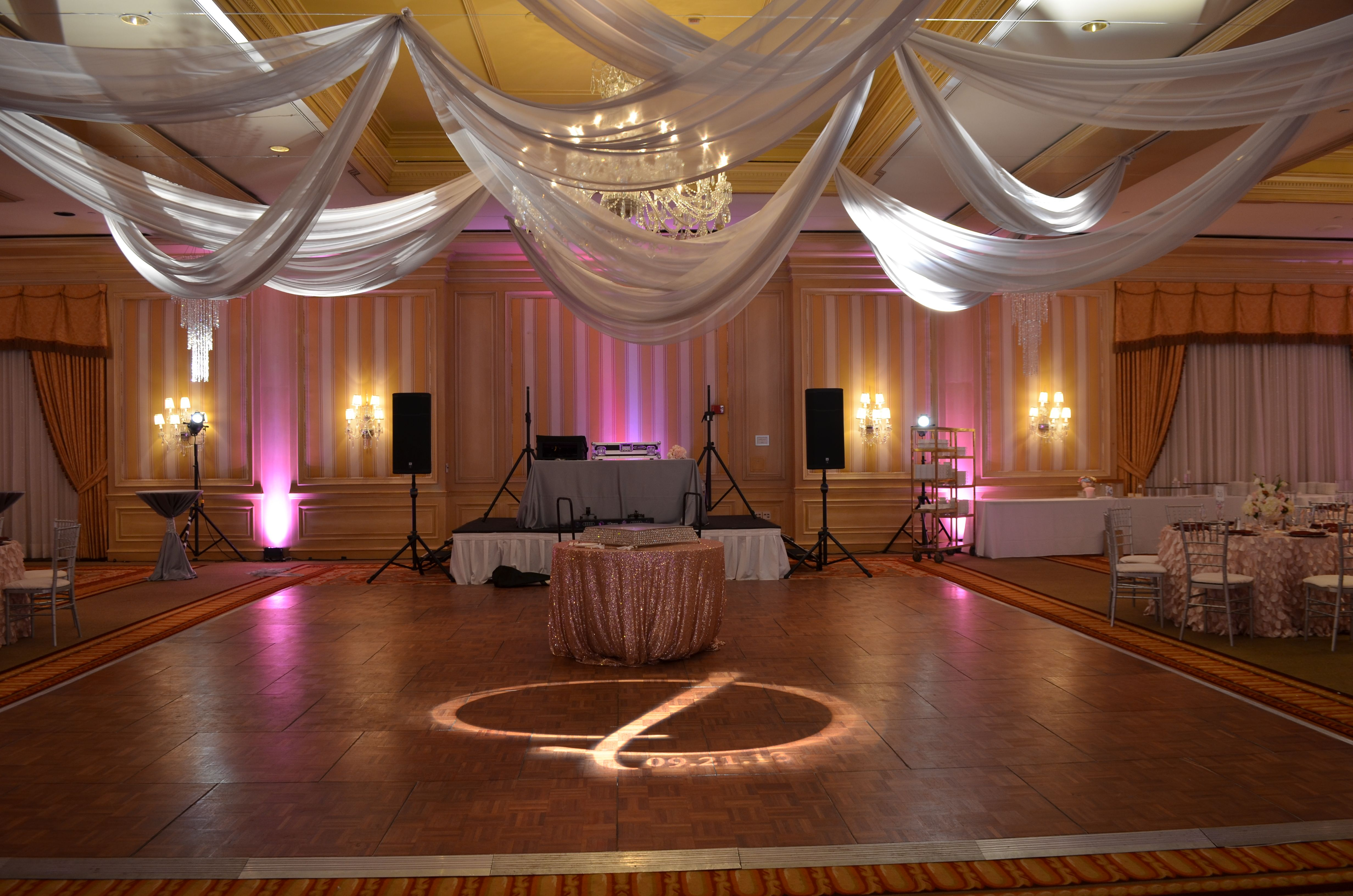 Wedding event background  Custom Gobo Ceiling Swags and LED uplighting at The Henry  Event