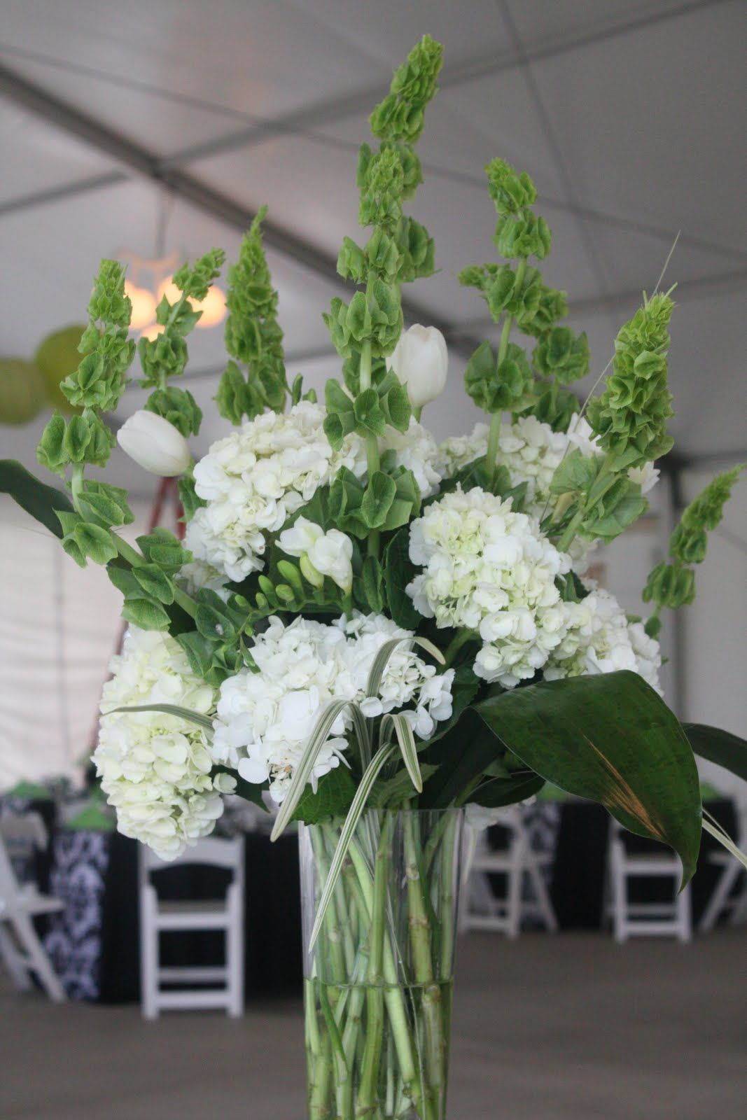 Bells Of Ireland Hydrangea Freesia Tulips Poms And Varigated Lily Grass And Asp Hydrangea Centerpiece Hydrangea Centerpiece Diy Wedding Floral Centerpieces