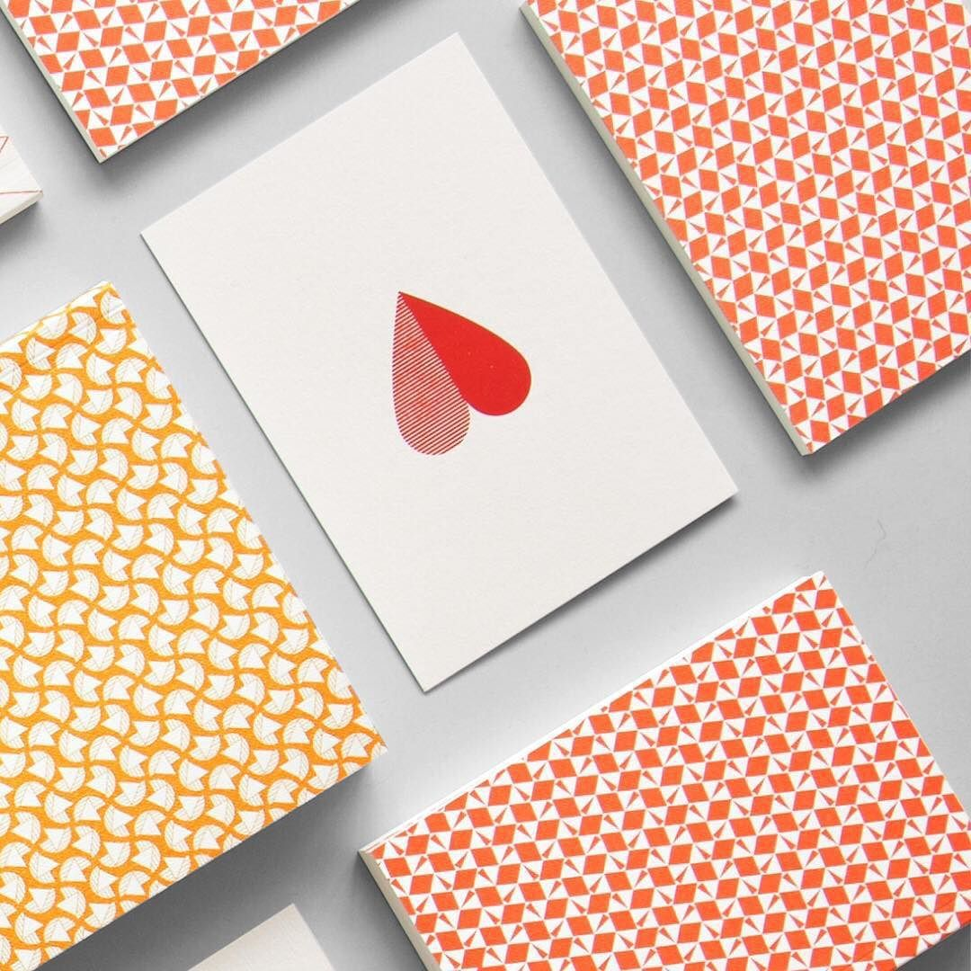 Red Shades Heart print card in red foil | Victor print pocket book in bright red | Curve print layflat notebook in cadmium yellow | #madeinbritain #stationery #pattern #graphic #simple #details by ola_studio